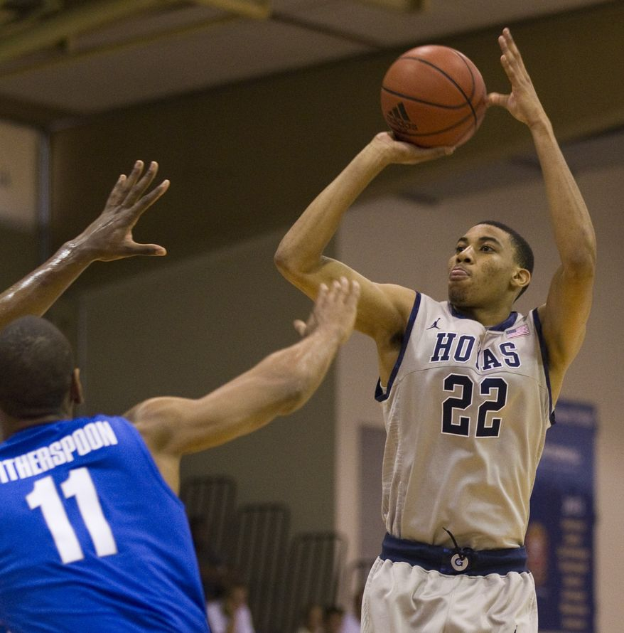 Memphis guard/forward Wesley Witherspoon (11) watches as Georgetown forward Otto Porter (22) puts up a jumpshot in the first half Wednesday, Nov. 23, 2011, in Lahaina, Hawaii. (AP Photo/Eugene Tanner)