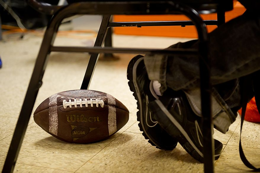 Coolidge High School Football Coach Natalie Randolph sits in the coaches locker room before going out to practice with her team to get ready for the Turkey Bowl, Washington, DC, Monday, November 21, 2011. (Andrew Harnik/The Washington Times)