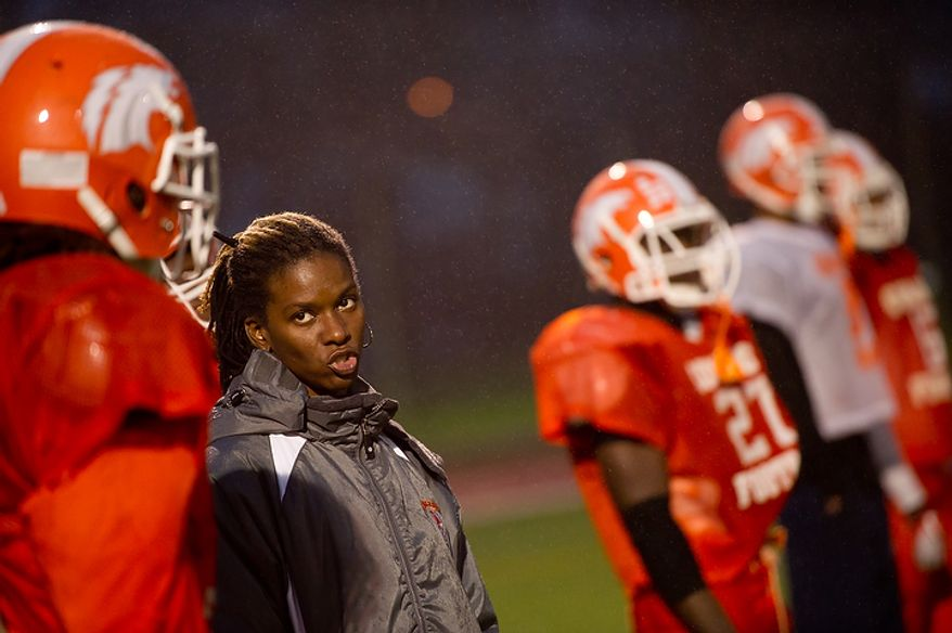 Coolidge High School Football Coach Natalie Randolph gets her team ready for the Turkey Bowl, Washington, DC, Monday, November 21, 2011. (Andrew Harnik/The Washington Times)