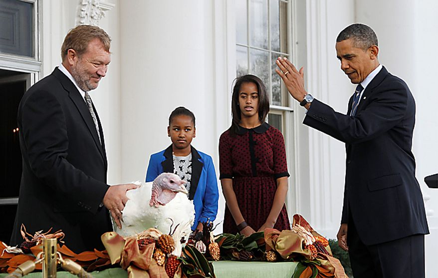 President Obama, with daughters Sasha and Malia, pardons Liberty, a 19-week-old, 45-pound turkey, at the White House on Nov. 23, 2011, the day before Thanksgiving. At left is National Turkey Federation Chairman Richard Huisinga. (Associated Press)