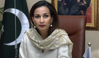** FILE ** In this March 31, 2008, file photo, Pakistan's former Information Minister Sherry Rehman is seen in her office in Islamabad, Pakistan. Rehman is Pakistan's ambassador to the United States. (AP Photo, file)