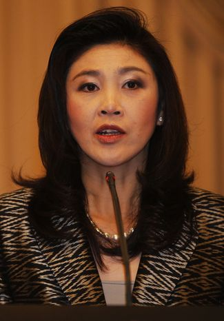 ** FILE ** Thai Prime Minister Yingluck Shinawatra answers reporters questions during a joint press conference with U.N. Secretary-General Ban Ki-moon at the Government House in Bangkok, Thailand, on Wednesday Nov. 16, 2011. (AP Photo/Damir Sagolj, Pool)