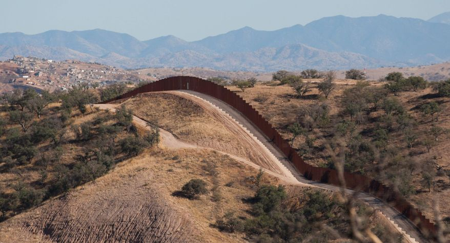 This portion of a border fence stretches west of Nogales, Ariz., into the Coronado National Forest. An Arizona lawmaker, Republican state Sen. Steve Smith, who is leading an effort to build additional fences near the state's border with Mexico through donations, said he expects to begin construction on more barriers next year. (The Arizona Republic via Associated Press)