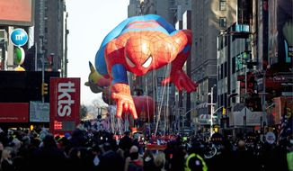"The ""Spiderman"" float is manuevered through Times Square by handlers during the Macy's Thanksgiving Day Parade iin New York on Thursday. (Associated Press)"
