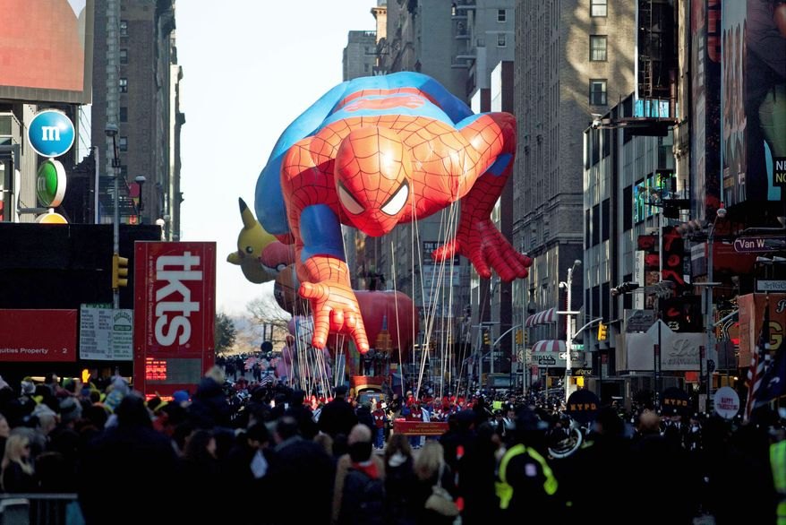 """The """"Spiderman"""" float is manuevered through Times Square by handlers during the Macy's Thanksgiving Day Parade iin New York on Thursday. (Associated Press)"""
