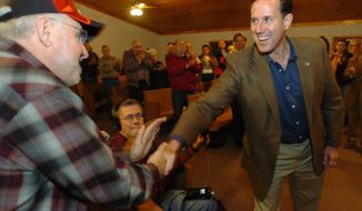 Republican presidential hopeful Rick Santorum greets Gary Gahan, 66, of Merrimack, N.H., at a recent campaign stop in Rochester, N.H. The former senator from Pennsylvania hopes to do well in the Granite State's Jan. 10 first-in-the-nation primary. (Associated Press)