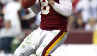 Washington Redskins quarterback Rex Grossman has played fairly well in two games since reclaiming the starting-quarterback job. He threw for 292 yards, a touchdown and an interception in the 27-24 overtime loss to the Dallas Cowboys last Sunday. (AP Photo/Evan Vucci)