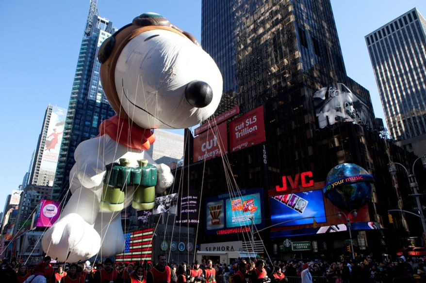 The Snoopy float is seen during the Macy's Thanksgiving Day Parade in Times Square in New York on Thursday, Nov. 24, 2011. The parade premiered in 1924, this is its 85th year. (AP Photo/Andrew Burton)