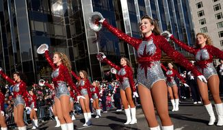 ** FILE ** Cheerleaders from the Alabama's Homewood High School Patriot Band march and cheer during Macy's Thanksgiving Day Parade. (AP Photo/John Minchillo)