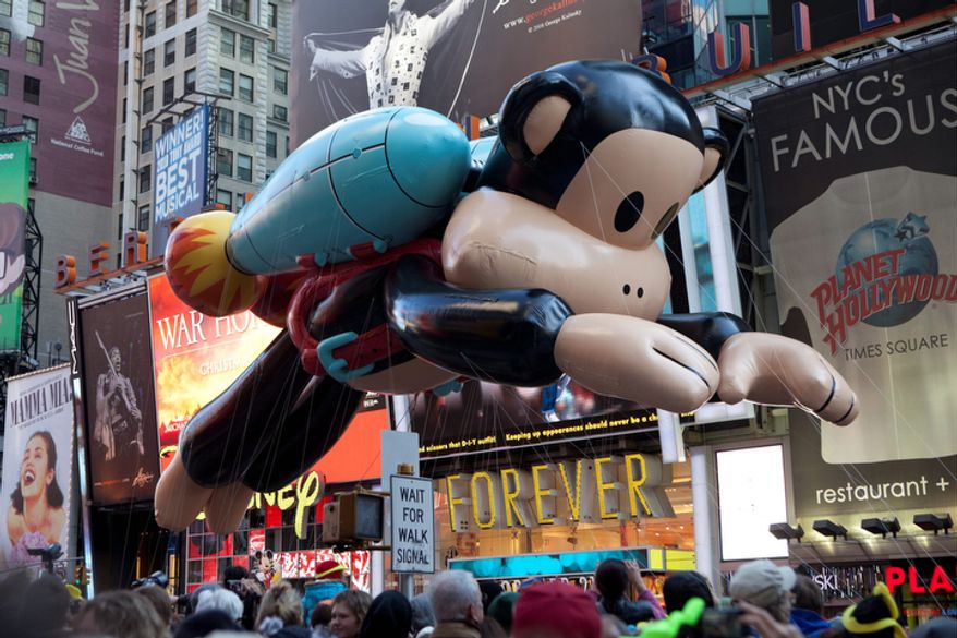 Julius, a jetpack-wearing monkey made by Paul Frank is seen during the Macy's Thanksgiving Day Parade. (AP Photo/Andrew Burton)