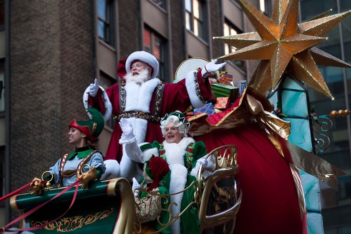 Santa Claus waves at spectators during the Macy's Thanksgiving Day Parade, Thursday, Nov. 24, 2011, in New York. (AP Photo/John Minchillo)