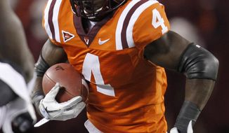 Virginia Tech running back David Wilson has 1,442 yards and seven touchdowns on the ground this season. (AP Photo/Steve Helber)