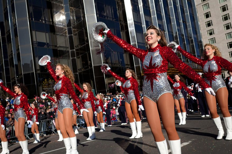 Cheerleaders from the Alabama's Homewood High School Patriot Band march and cheer during Macy's Thanksgiving Day Parade.  (AP Photo/John Minchillo)
