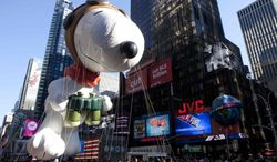 "The ""Snoopy"" float is seen during the Macy's Thanksgiving Day Parade in Times Square in New York on Thursday, Nov. 24, 2011. The parade premiered in 1924; this is its 85th year. (AP Photo/Andrew Burton)"