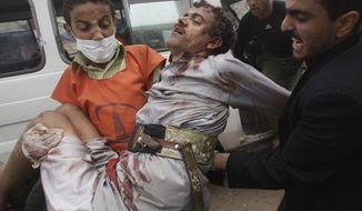 A wounded protestor is carried from the site of clashes with security forces in Sanaa, Yemen, Thursday, Nov. 24, 2011. (AP Photo/Hani Mohammed)