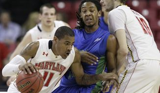 Maryland forward Mychal Parker, left, drives past Florida Gulf Coast guard Sherwood Brown, center, as Brown is screened by Maryland center Berend Weijs in the first half in College Park, Md., Friday, Nov. 25, 2011. Parker had five points, five rebounds and three assists in the 73-67 win. (AP Photo/Patrick Semansky)