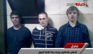 **FILE** In this image from Egyptian state television, three American students are displayed Nov. 22, 2011, to the camera by Egyptian authorities following their arrest during protests in Cairo, where an Egyptian official said they were throwing firebombs at security forces. (Associated Press)
