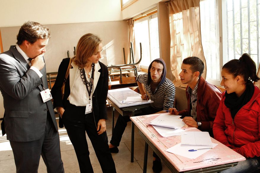 Observers from Spain speak with political party's representatives in a polling station in Rabat, Morocco, on Nov. 25, 2011. Moroccans voted for a new parliament that day in Arab Spring-inspired elections. (Associated Press)