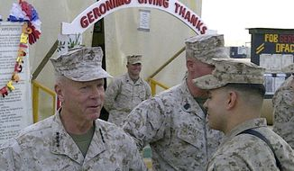 Marine Gen. James Amos visits Combat Outpost Geronimo in southern Afghanistan, Thursday, Nov. 24, 2011. (AP Photo/Robert Burns)