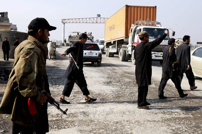 Pakistani security personnel stop trucks carrying supplies for NATO forces in neighboring Afghanistan at Takhtabeg check post in Pakistani tribal area of Khyber, Pakistan, on their way to Torkham border post on Saturday, Nov 26, 2011. Pakistan on Saturday accused NATO helicopters of firing on two army checkpoints in the northwest and killing 25 soldiers, then retaliated by closing a key border crossing used by the coalition to supply its troops in neighboring Afghanistan. (AP Photo/Muhammad Sajjad)