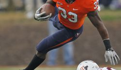 Virginia running back Perry Jones only had 13 yards as part of a 30-yard rushing day for the Cavs in their loss to the Hokies on Saturday. (AP Photo/Steve Helber)