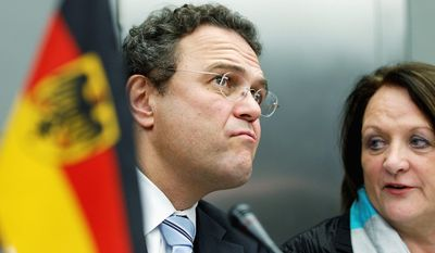 German Interior Minister Hans-Peter Friedrich and German Justice Minister Sabine Leutheusser-Schnarrenberger were part of a meeting in Berlin this month to discuss the nation's fight against neo-Nazis. (Associated Press)