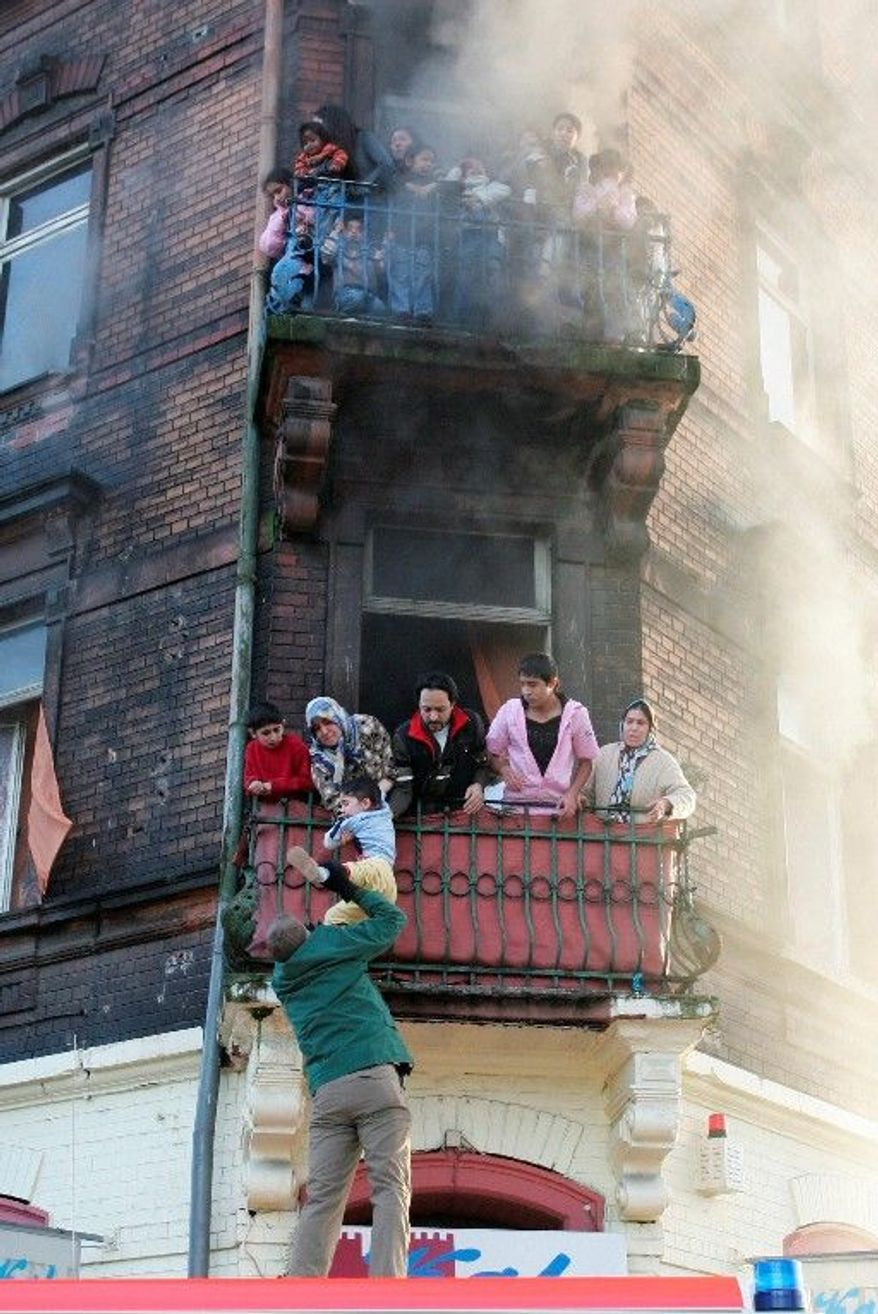 Nine Turkish immigrants, including five children, were killed in an apartment fire on Feb. 3, 2008, in Ludwigshafen, Germany. Authorities have reopened the case and suspect it is the work of a small band of neo-Nazis. (Associated Press)