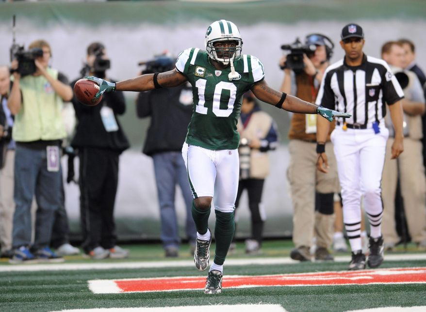 Jets wide receiver Santonio Holmes celebrates what turned out to be the game-wiining touchdown Sunday against the Bills. (Associated Press)