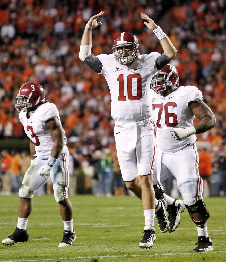"Alabama quarterback AJ McCarron (10) and the Crimson Tide are likely ""in the clubhouse"" awaiting their opponent - most likely top-ranked LSU - in the BCS title game after defeating Auburn on Saturday. LSU faces Georgia for the SEC championship next weekend, which features plenty of big matchups on paper, but none of the outcomes is likely to prevent an LSU-Alabama rematch for the national championship. (Associated Press)"