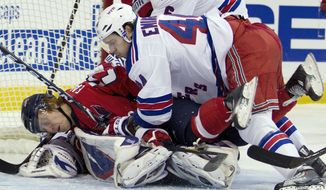 When push came to shove, Steve Eminger and the Rangers had plenty of both in their 6-3 win over the Capitals on Friday. The following night, Tomas Vokoun watched a goal celebration time and again in a 5-1 loss at Buffalo. (Associated Press)