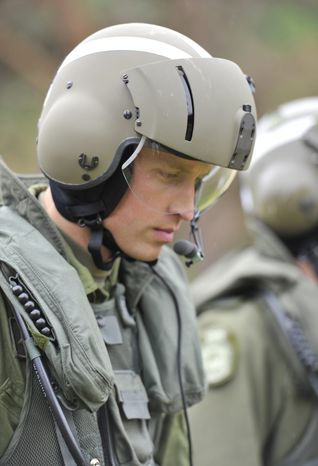 ** FILE ** Britain's Prince William heads toward a Sea King helicopter for a training exercise in Dalvay-by-the-Sea on Canada's Prince Edward Island on Monday, July 4, 2011. (AP Photo/The Canadian Press, Paul Chiasson)