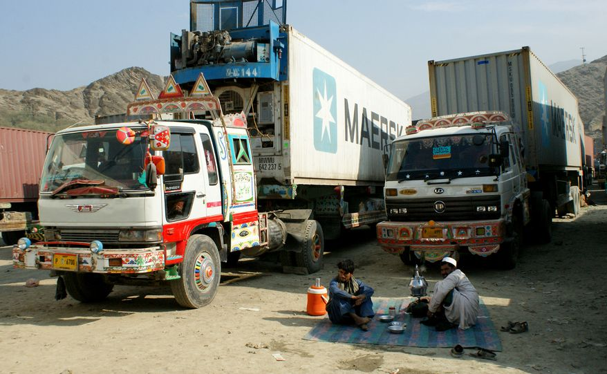 Afghanistan-bound trucks carrying supplies for NATO forces are forced to park after authorities closed the Torkham border crossing in Pakistan on Sunday, Nov. 27, 2011. (AP Photo/Qazi Rauf)