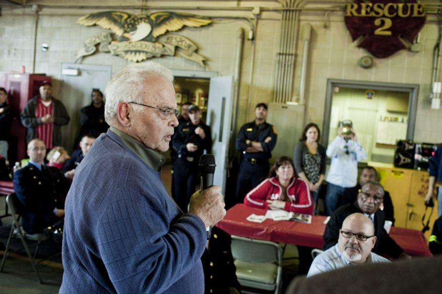John Lockwood, a retired battalion fire chief in the D.C. Fire Department and former member of Engine Co. 24, speaks during Engine Company 24's centennial celebration.(T.J. Kirkpatrick/ The Washington Times)