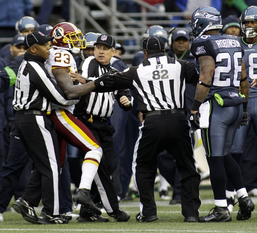 Seattle Seahawks' Michael Robinson and Washington Redskins' DeAngelo Hall are separated by officials after a scuffle in the first half of an NFL football game, Sunday, Nov. 27, 2011, in Seattle. (AP Photo/Ted S. Warren)