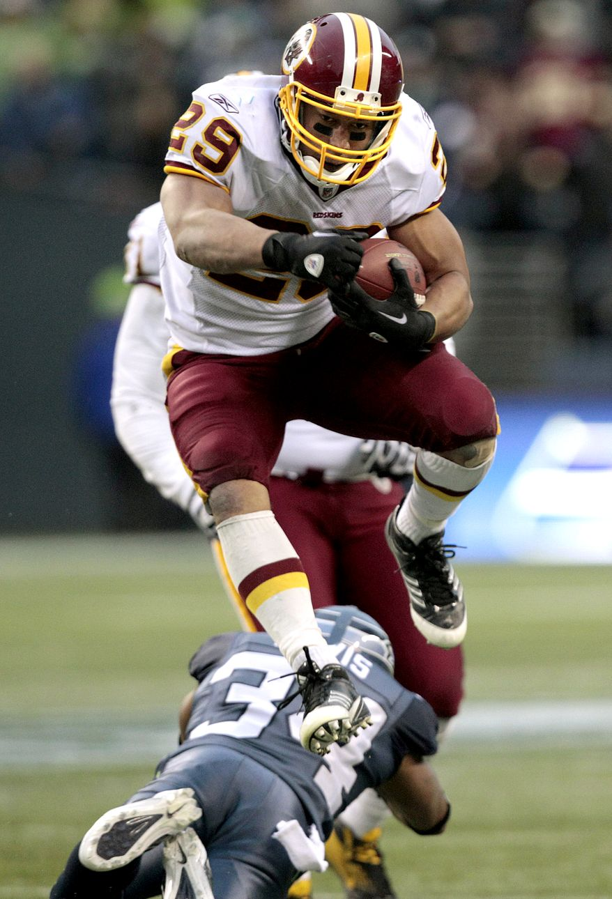 Washington Redskins running back Roy Helu ran for 128 yards and a touchdown in the Redskins' 23-17 win against the Seattle Seahawks on Sunday. (AP Photo/Elaine Thompson)