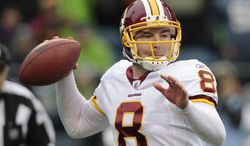 Washington Redskins quarterback Rex Grossman sets to throw in the first quarter of an NFL football game, Sunday, Nov. 27, 2011, in Seattle. (AP Photo/Elaine Thompson)