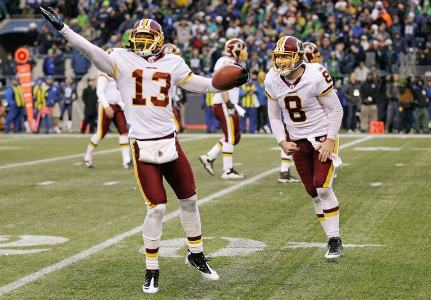 Washington Redskins' Anthony Armstrong, left, celebrates his touchdown with quarterback Rex Grossman, right, in the second half. (AP Photo/Ted S. Warren)