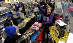 Customers pile purchases into their carts at a Best Buy store in Burbank, Calif., on Black Friday. Cyber Monday, Green Tuesday and Magenta Saturday have become part of a color-coded shopping experience between Thanksgiving and Christmas. (Associated Press)