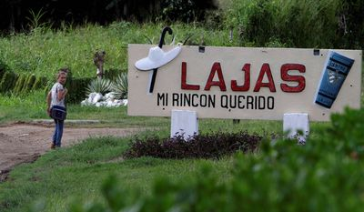 """The entrance to Santa Isabel de Las Lajas bears the name of native son Benny More's 1955 song """"Lajas, Mi Rincon Querido"""" (""""Lajas, My Beloved Place""""). Small businesses are sprouting where the once-lucrative sugar-cane industry has declined. (Associated Press)"""