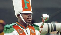 Robert Champion, a drum major in Florida A&M University's Marching 100 band, performs during halftime of a football game in Orlando, Fla., on Saturday, Nov. 19, 2011. (Tampa Tribune via Associated Press)