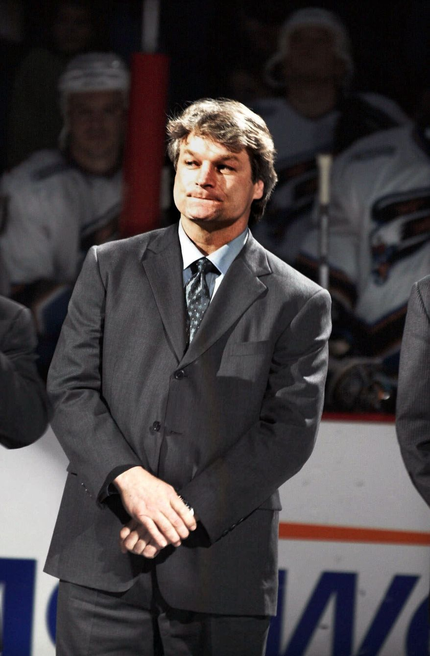 ** FILE ** Former Washington Capitals hockey player Dale Hunter listens as his jersey number is retired during at ceremony at the MCI Center in Washington in March 2000. (AP Photo/Linda Spillers, File)