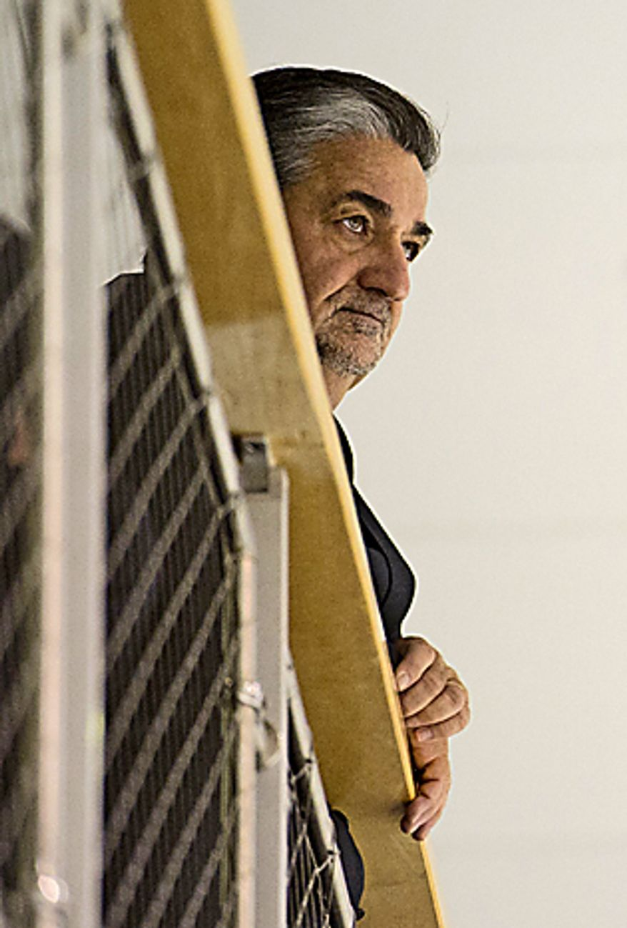 Washington Capitals owner Ted Leonsis watches from above as the Caps' new head coach, Dale Hunter, takes to the ice with the team for the first time at the Kettler Capitals Iceplex in Arlington on Monday, Nov. 28, 2011. (Rod Lamkey Jr./The Washington Times)
