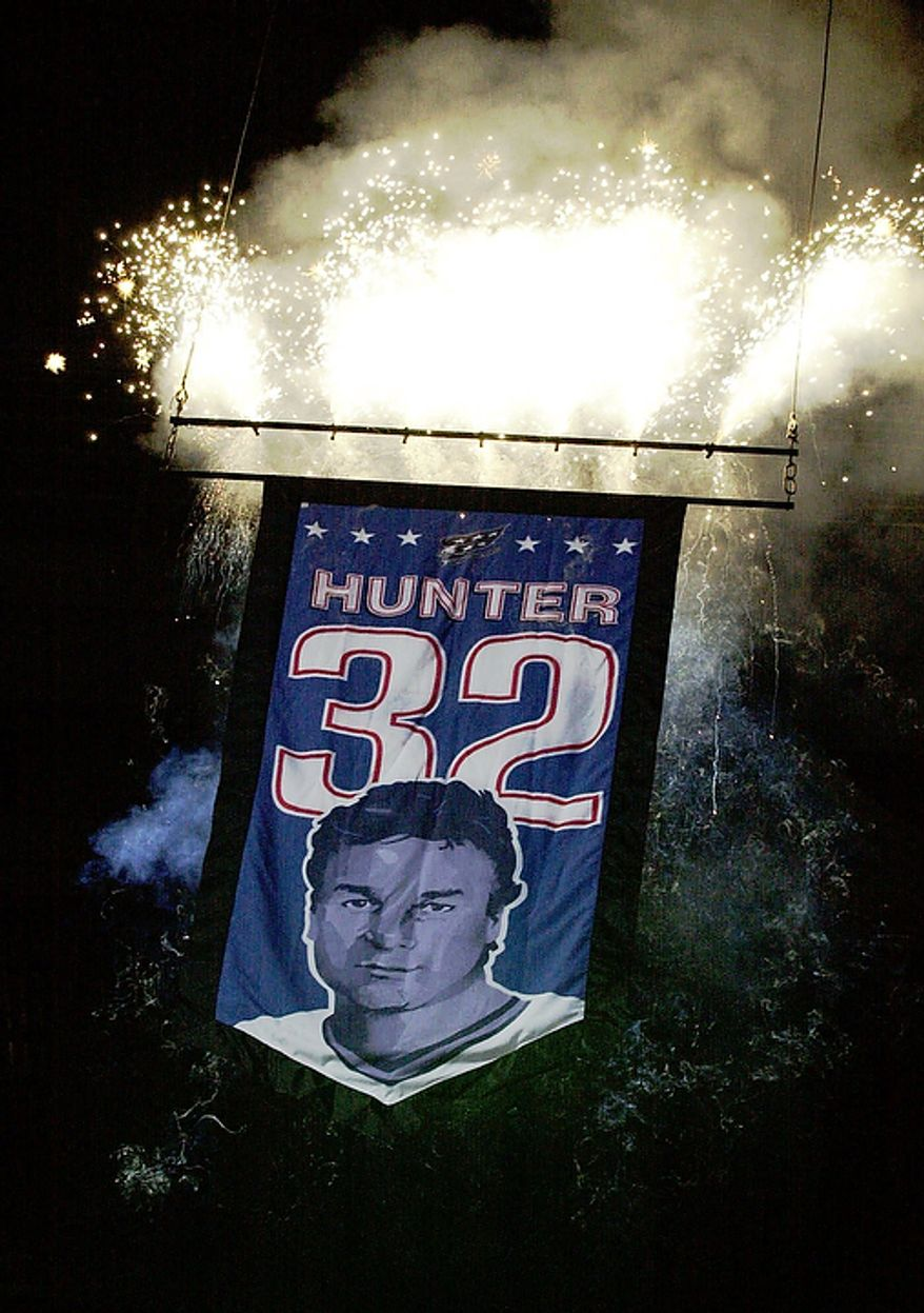 In this March 11, 2000 file photo, a banner with the uniform number of retired Washington Capitals' Dale Hunter is raised at the MCI Center in Washington. The Capitals fired coach Bruce Boudreau Monday Nov. 28, 2011. Boudreau was replaced by former Capitals captain Dale Hunter. (AP Photo/Linda Spillers)
