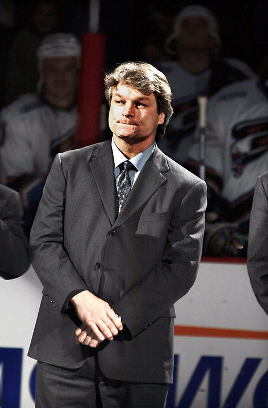 In this March 11, 2000 file photo,†Washington Capitals' Dale Hunter listens during a ceremony in which his jersey number was retired, before the Capitals' game against the New Jersey Devils, at the MCI Center in Washington. The Capitals fired coach Bruce Boudreau Monday Nov. 28, 2011. Boudreau was replaced by former Capitals captain Dale Hunter. (AP Photo/Linda Spillers, File)