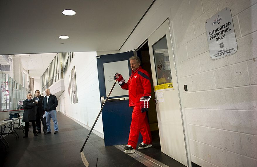 New Washington Capitals Head Coach Dale Hunter walks from the locker room as he takes to the ice with his team as they practice together for the first time, at the Kettler Capitals Iceplex in Arlington, Va, Monday, November 28, 2011. (Rod Lamkey Jr/ The Washington Times)