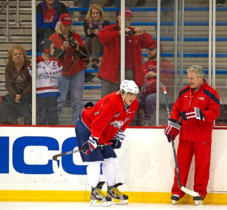 New Washington Capitals Head Coach Dale Hunter chats with Alex Ovechkin as he takes to the ice with his team as they practice together for the first time, at the Kettler Capitals Iceplex in Arlington, Va, Monday, November 28, 2011. (Rod Lamkey Jr/ The Washington Times)