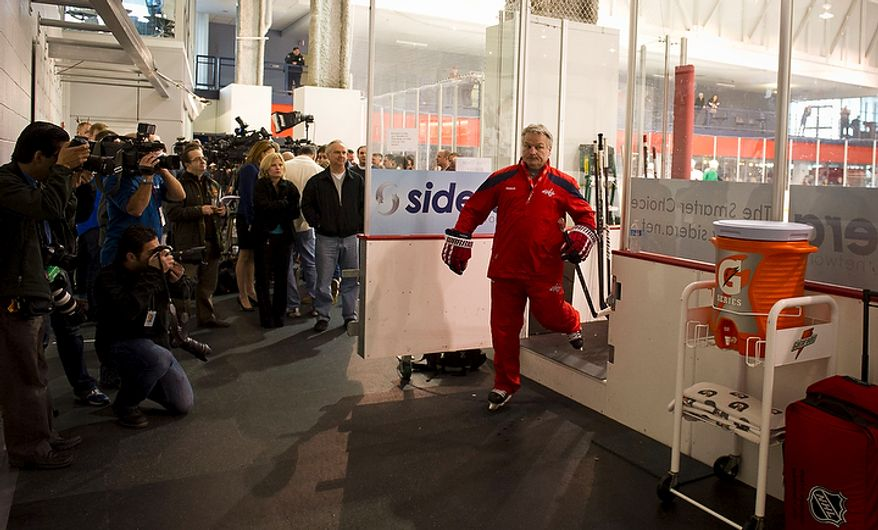New Washington Capitals Head Coach Dale Hunter makes his exit from the ice after taking practice with his team for the first time, at the Kettler Capitals Iceplex in Arlington, Va, Monday, November 28, 2011. (Rod Lamkey Jr/ The Washington Times)