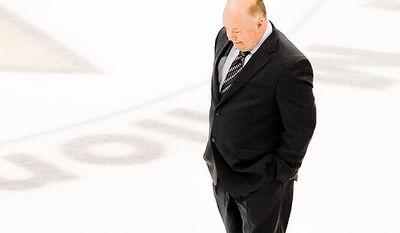 Head coach of the Washington Capitals Bruce Boudreau walks to his bench before his team started overtime play against the Pittsburgh Penguins in game 6 of the 2nd Round of the NHL Playoffs at Mellon Arena in Pittsburgh, Pa. Monday, May 11, 2009. (Michael Connor / The Washington Times)