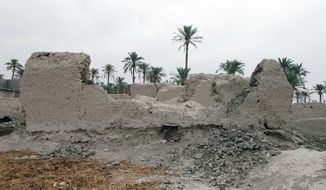 Ruins of homes destroyed by Iranian artillery during the Iran-Iraq war of 1980-88 remain standing in Mandali, a mixed Kurdish-Arab city about 60 miles northeast of Baghdad. (Associated Press)