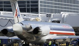 ** FILE ** In this June 6, 2011, file photo, an American Airlines aircraft nears Terminal D gate at Dallas-Fort Worth International Airport, in Grapevine, Texas. American Airlines and American Eagle's parent companies are filing for Chapter 11 bankruptcy protection on Tuesday, Nov. 29, 2011. (AP Photo/Tony Gutierrez, File)